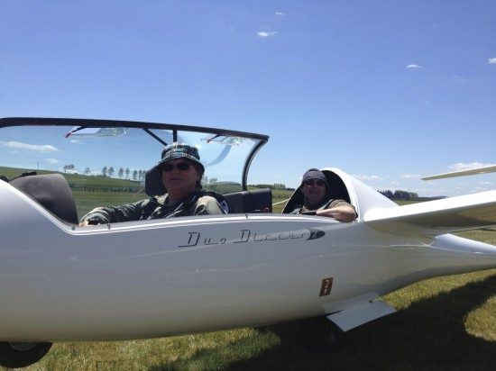 Neil and Robert ready to launch into an impressive sky behind